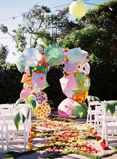 What a whimsical wedding idea! FInd parasols like these for sale at splendorforyourguests.com! Splendor for Your Guests | Rental Company | Weddings | Events | Shawls | Blankets | Umbrellas | Parasols | Fans