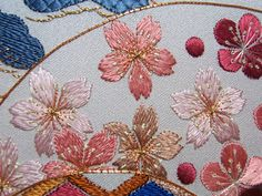 Threads Across the Web: Cherry and Plum Blossoms. Lovely blog full of information and inspiration on Japanese embroidery and other kinds of needlework. I love the gold thread here.