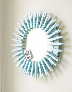 Clothespin mirror. This is a really cool idea, tho I'd probably put the clothespins going the other way.
