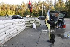 Member of Right Sector party unfolds flag in front created a... #mukacheve: Member of Right Sector party unfolds flag in front… #mukacheve