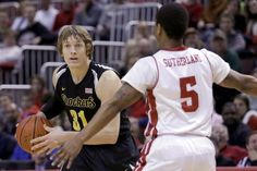 Wichita State guard Ron Baker (31) looks to pass against Bradley guard Tramique Sutherland (5) during the first half of an NCAA college basketball game Wednesday, Feb. 4, 2015, in Peoria, Ill. (AP Photo/ Stephen Haas)