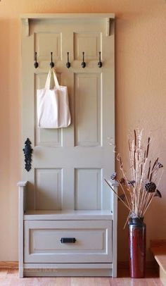 For downstairs entry - A fun DIY transformation: a reclaimed door is the base for this entry bench.