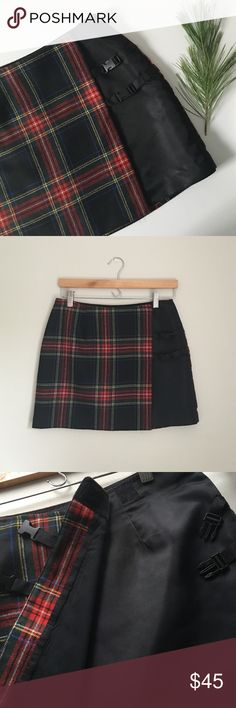 Rare Express Tartan Plaid Mini Skirt Tartan plaid wrap mini skirt by Express. Velcro and buckle fasteners across the front. Small Fully lined. Small tear on hem of lining - not noticeable. Skirt is in impeccable condition! Size 3/4. Express Skirts Mini