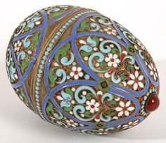 Russian Silver Champleve Enamel Egg with red cabochon gem at top. Circa late 19th Century.