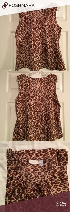 Chico's size 3 animal print sleeveless blouse Chico's size 3 (16/XL) brown/tan/pale pink animal print sleeveless blouse. There are some gathers & darts around the front neckline & hip slits for easy fit. 97%poly/3%spandex. Easy wash & wear. Excellent condition. Gently worn. Non smoking environment. Pet friendly household. Chico's Tops Blouses