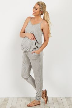Slip into comfort and style with this chic sleeveless maternity jumpsuit. On trend and ultra comfy this jumpsuit will be your new go-to for everyday casual wear. Style this beauty with a light jacket and flats for a complete casual look.