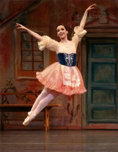 """Jenifer Ringer in """"Coppelia,"""" New York City Ballet. © Paul Kolnik. """"Jenifer Ringer's debut as Swanilda, the fun-loving heroine of """"Coppélia,"""" was everything the New York City Ballet's production's needed to raise it to its highest level. As a rule Ms. Ringer is more pearl than diamond in her dancing: luster has it over glitter. But here she surprised with a new and forceful attack, enhanced by sharp phrasing and delightful glances and asides. It was a sparkling portrayal."""""""