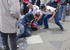 June 28, 2014, Veterans Day: a man is pressed to the ground by police and a thug in civil clothing for carrying the flag of what the Netherlands promised to be an independent state of West Papua. So it is an official flag instated by Dutch authorities. That independent state never came as the Nehterlands under pressure of the US turned the area over to Indonesia/ One is allowed to carry nazi-flags in parliament but not the flag of a people striving for freedom and independence.
