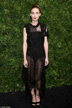 Gothic look: Rooney Mara, 30, wore a black body suit with a see-through black lacy skirt a...