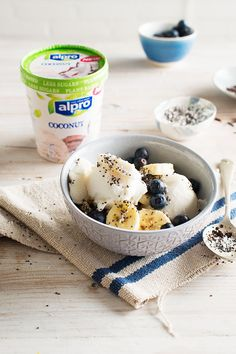 Stay on trend with this tasty flexbowl - top Alpro Coconut Ice Cream with bananas, blueberries and chia seeds for a totally tropical, easy, and delicious dessert.