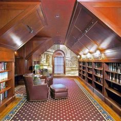 An attic library....if it just had a billiards table, it would be perfect.