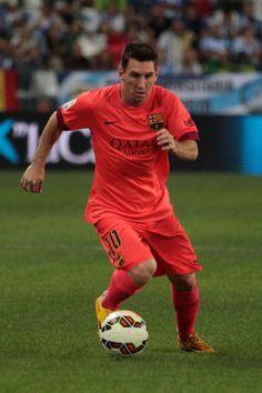 Lionel Messi of F.C. Barcelona controls the ball during the La Liga match between Malaga CF and FC Barcelona at La Rosaleda studium on September 24, 2014 in Malaga, Spain.