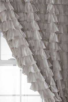 ruffled curtain from urban outfitters. Backdrop idea. Grey ruffles on either side with ribbons and lace in between?