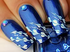 Nail art tutorial : blue feathers
