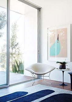 Harry Bertoia´s Diamond chair and Eero Saarinen´s Tulip side...