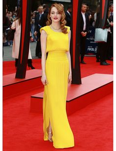 Emma Stone wears a yellow Atelier Versace pleated open-back custom dress with a David Webb 18k gold double lion necklace to the premiere of The Amazing Spider-Man 2.