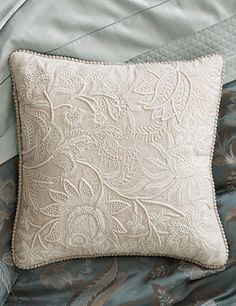 The Linwood pillow has thickly detailed crewelwork stitches, Frenchknotting, and a brocade trim.