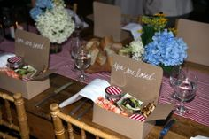 Kraft picnic box dinner with Maine lobster rolls and salads in mason jars