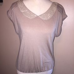 American Eagle Peter Pan Collar Shirt XS This sweet shirt is a the perfect mix of feminine comfort. American Eagle. Size Small. A soft creamy tan color. Sequins form a Peter Pan collar to dress this shirt up. There is some slight pilling of fabric.  This shirt has an elastic waist at the bottom American Eagle Outfitters Tops Blouses