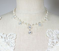 Classic Victorian style bridal jewelry, this necklace features extremely sparkling cubic zirconia oval stones set in silver and hung from a