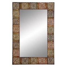 Wall mirror with an embossed multicolor metal frame.