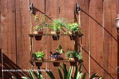 Hanging Planter, Terra Cotta Pots, Wood, Garden Planter. $89.95, via Etsy.