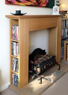 This is kind of brilliant - hack an IKEA dvd tower into a storage mantle. Faux Mantle, Faux Fireplace Mantels, Diy Mantel, Fireplace Surrounds, Mantles, Small Fireplace, Farmhouse Fireplace, Fireplaces, Shoe Storage Ikea Hack