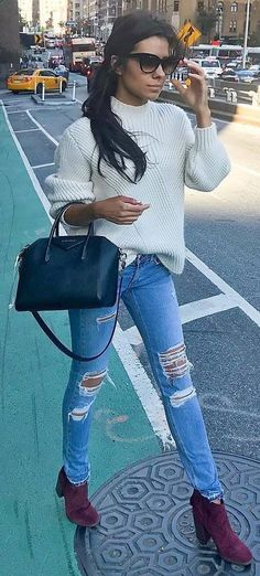 how to style a sweater bag ripped jeans maroon boots
