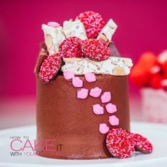Almond nougat, valentine milk chocolates, mini candy lips, and tasty Toblerone are sitting pretty on top of my mini chocolate Valentine's Day Cake. Filled and iced with chocolate buttercream. <3 #Baking #Dessert