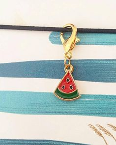 A single watermelon charm fixed to a 16mm lobster clasp. Perfect for attaching to your planner or TN, used as stitch marker or progress keeper or as a zipper or purse charm.