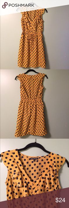 Yellow and Navy Polka Dot Dress Adorable yellow dress with navy Polka dots. Cute ruffled v-neck; drawstring elastic waistband for better fit; side pockets for all your goodies; and full-lined skirt. BeBop Dresses