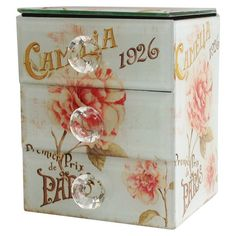 Featuring a French typographic motif and floral accent, this charming 3-drawer jewelry box brings worldly appeal to your master suite or powder room.