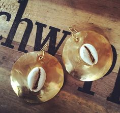 A personal favorite from my Etsy shop https://www.etsy.com/listing/273522694/large-gold-earrings-with-cowrie-shell