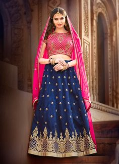 Featuring a regal pink and navy blue lehenga set intricately crafted with resham and zari work.It is paired with matching choli material and georgette duppata.This outfit can be stitched upto size 44. For stitching enquiries, please email at customercare@hunardesigns.com   |…