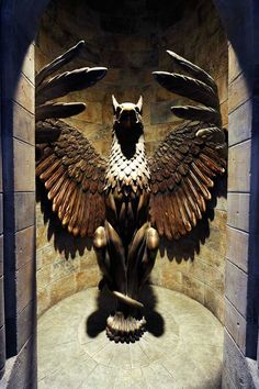 The regal Griffin statue stands on the way to Dumbledore's office