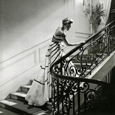 """Christian Dior's """"Liszt"""" evening gown on the staircase of Dior's salon, 1950"""