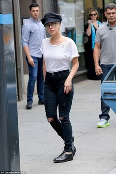 Fiddler on the move: Make-up free Lady Gaga stepped out of her New York recording studio in a glasses and fiddler cap combo on Friday