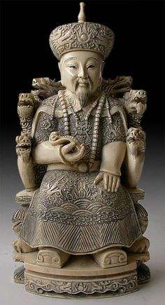 Antique Chinese Ivory Carving Quan Long Emperor Seated on Nine Dragon Throne Dated: Quan Long. Attributed to early 20th century