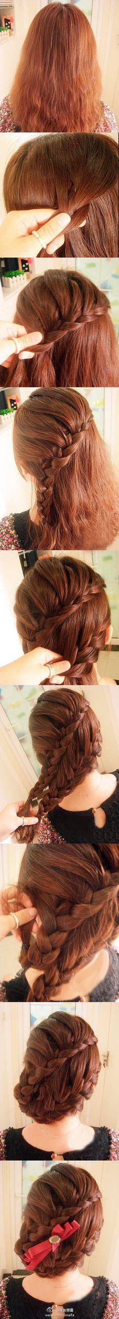 Double diagonal braid....Awesome survivalist hair, if you skip the bow and add in some twine....