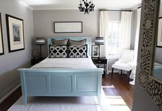 bedroom, black furniture, blue, cream, curtains, gray, white, white furniture, wood floor