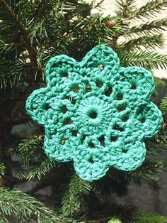 Crochet a quick and simple doily for an ornament. | 34 Adorable Things To Do With Leftover Bits OfYarn
