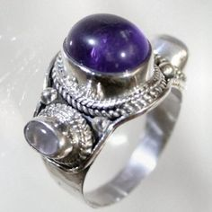 'Amethyst and Moonstone Trinity Ring 925 SS Sz 7.25  ' is going up for auction at  3pm Sun, May 12 with a starting bid of $1.