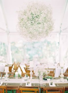 What a clever way to make baby's breath look luxurious! An ethereal wedding tent chandelier