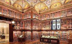 We are in the East Room of the Morgan Library, in NY. Hundreds of volumes are locked away like cloistered nuns behind slender metal gratings. We climb the wooden staircase to the third landing: it's like standing at the rail of an ocean liner ,a ship or even an eighteenth century Italian theater, its tiered boxes illuminated by the crystal drops of a magnificent chandelier.(from P.O. Box Love, by Paola Calvetti)