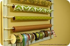 DIY paper storage - such a great way to store all of those wrapping paper rolls.  Husband used a pre-fab frame and dowels from Michael's...spray painted and fastened hooks on both sides.