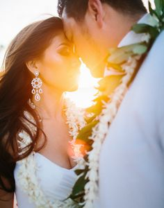 Gorgeous photo! I want Dan to hire a photographer and surprise me with a vow renewal in Hawaii!