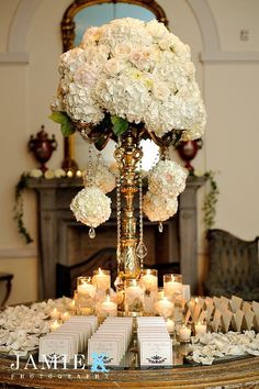 Chic white floral wedding reception decor; Featured Photographer: Jamie K Photography