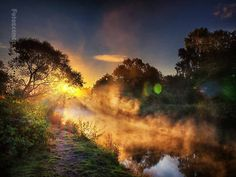 Amazing image... love the steam rising over the water and the use of sun flare is superb.