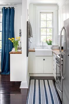 Rethink the Floor Plan - Tiny Kitchen Inspiration That You'll Want To Pin - Southernliving. Remember those appliances we mentioned that couldn't fully open? That was the reality for this 60-square foot kitchen before its renovation. Designer Kiera Kushlan tore down an 8-foot section of the wall, brightened with white, and moved the sink to create an open, airy space previously unimaginable in the cramped quarters.