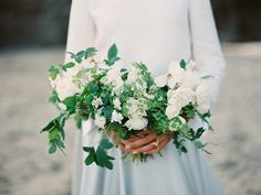 White bridal bouquet (Floral design: Soil & Stem assisted by Tess Comrie) - Modern Seaside Inspiration by Ginny Au, assisted by Charlene Tea (Creative direction & styling), Kaela Rawson (Art Direction) + Tenth & Grace (Photography) Captured at Erich Mcvey Workshop) - via Magnolia Rouge